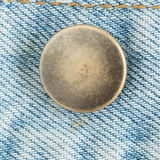 Old metal button of jeans Royalty Free Stock Photos