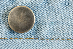 Old metal button of jeans Stock Photos