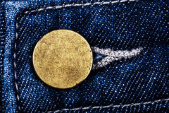 Old metal button of jeans Royalty Free Stock Image