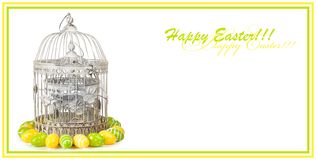 Old metal cage with easter eggs on white isolated background stock images