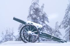 Old metal cannons covered with snow royalty free stock image