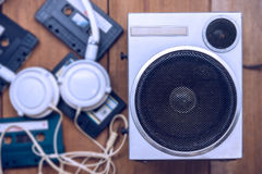 Old metal case speaker with tape and headphone stock photo