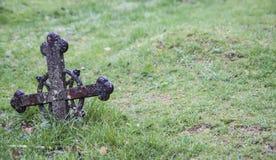 Ancient metal christian cross on green grass. Old metal christian cross on green grass royalty free stock image