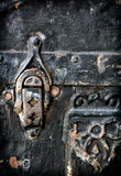 Old Metal Clasp. A detailed close up of a clasp on an old antique luggage trunk royalty free stock photography