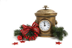 Old metal clock with Christmas decorations isolated on white Royalty Free Stock Photography