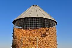 Metal corn crib full of harvested ears of corn royalty free stock photo
