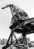 Old metal crane in Strasbourg harbor, industrial and vintage. France Stock Image