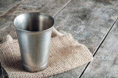 Old metal cup on wooden table Royalty Free Stock Photography