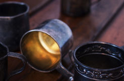 Old Metal Cups. On wood Royalty Free Stock Image