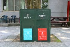 Old metal dark green bins located in a public place for different garbage recycling and general trash royalty free stock images