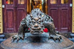 The old metal devil monster statue Stock Photography
