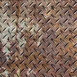Old metal diamond plate in brown color Royalty Free Stock Images