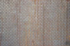Old metal diamond plate or old checkered steel plate with rusty. Stock Photo