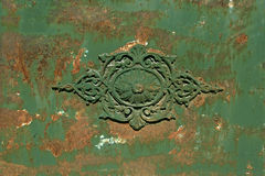 Old metal door. Old metal green door with  corrosion and decoration Stock Images