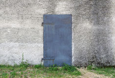 Old metal door on facade Stock Image