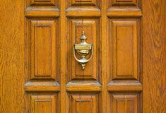 Old metal door handle knocker Royalty Free Stock Images