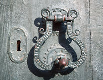 Old metal door handle mediterranean style Stock Photography