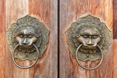 Old Metal Door Handle. Old metal ornamental brass door handle close-up Stock Photos