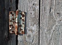 Old metal door hinge on wooden door Royalty Free Stock Photos