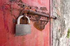 Old metal door with padlock in grungy style Stock Photos
