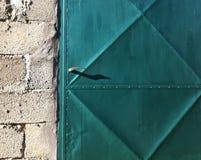 Old metal door. Metal painted blue - green outside door Stock Photography