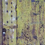 Old metal door with peeling green paint. Rusty metal surface royalty free stock photo