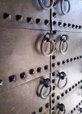 Old metal door with rivets stock photography