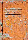Old metal door texture. With bright cracked painting Royalty Free Stock Images