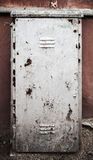 Old metal door texture. With gray cracked painting Stock Image