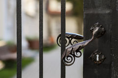Old metal doorknob, gate. Old metal doorknob, finesse blacksmith work Royalty Free Stock Photo