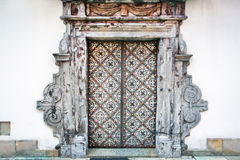 Old metal doors of white building. In Krakow, Poland Stock Photos