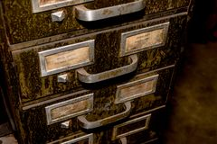 Old metal drawer file with green dirt and grime stock image