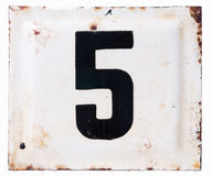 Old metal enamel plate with number five. Isolated Royalty Free Stock Image
