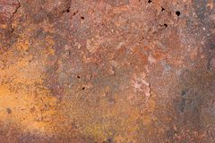 Old metal exfoliating sheet with red and yellow rust, texture. Old metal exfoliating sheet with red and yellow rust, holes and cracks, texture Royalty Free Stock Photo