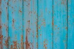Old metal fence aquamarine color with traces of rust stock photos