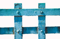 Old metal fence painted in blue. On white isolated Stock Photos
