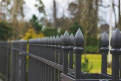 Old metal fence in the park stock photo