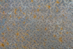 Old metal floor plate with diamond pattern and rusty background Stock Photo