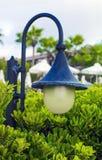 Metal garden lantern in green bushes royalty free stock photos