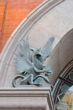 Old Metal Gargoyle on Arched Doorway Stock Photos