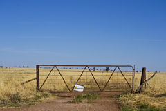Old metal gate and dirt track near Parkes, New South Wales Royalty Free Stock Photography