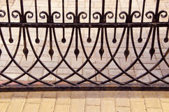 Old metal gate fragment. Beautiful forged metal ornaments Stock Photo