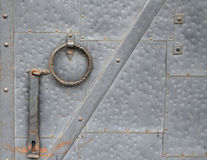 Old metal gate with signs of wear. Abstract background Stock Photography