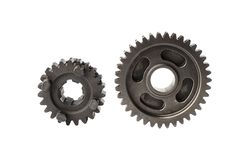 Old metal gear wheel or pinion part , Motorcycle Gear driven gear reduction ratio  isolated on white background. Old metal gear wheel or pinion part , Motorcycle royalty free stock photography