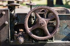 Old metal gears in drive mechanisms. Rusty gears used in machine Royalty Free Stock Photography