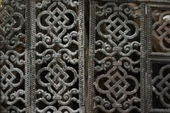 An old metal grille. Composed of patterned openwork plates with oriental ornament stock image