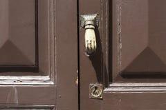 Old metal hand door knockers Royalty Free Stock Photos