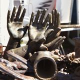 Old metal hand statuettes. Stock Photos