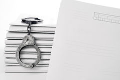 Old metal handcuffs and blank case file. Handcuffs and case file blank Stock Photo