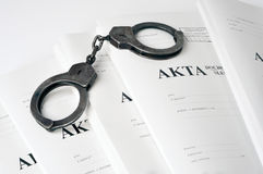 Old metal handcuffs and blank case file. Handcuffs and case file blank Stock Photography